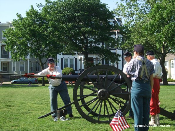 Dan Wood prepares the cannon for firing
